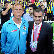 Fenerbahce's coach Christoph DAUM (L) and Trabzonspor's coach Senol GUNES (R) during their Turkish superleague soccer derby match Fenerbahce between Trabzonspor at the Sukru Saracaoglu stadium in Istanbul Turkey on Sunday 16 May 2010. Photo by TURKPIX