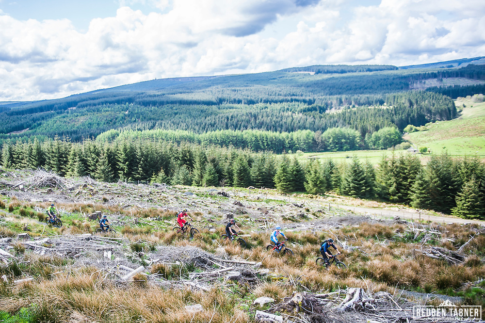 Mountain bikers riding through clear fell at Kielder Forest in Northumberland.