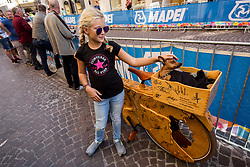 Girl with a dog on a wooden bike during the Men Under 23 Road Race 179.9km Race from Kufstein to Innsbruck 582m at the 91st UCI Road World Championships 2018 / RR / RWC / on September 28, 2018 in Innsbruck, Austria.  Photo by Vid Ponikvar / Sportida