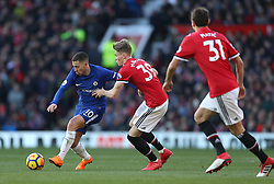Chelsea's Eden Hazard (left) and Manchester United's Scott McTominay battle for the ball