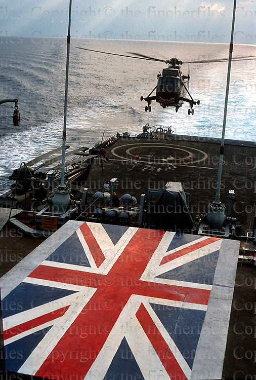 A Sea King helicopter takes off from the deck of HMS Fearless on a flight to Beirut to pick up a Royal Navy team that has been operating at a British outpost.Dec 1983. Photograph by Terry Fincher