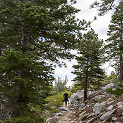 A woman hiking the Sherwin Lakes Trail into the John Muir Wilderness in Mammoth Lakes, California.