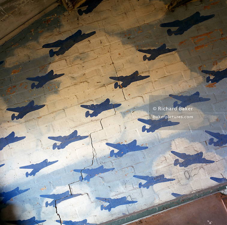 A wall mural of WW2 bombers crossing the sky at the former RAF Hethel air for base in Norfolk, England. Built during 1942 for use by the Americans and was transferred to the USAAF from 14 September 1943 though to 12 June 1945. Hethel served as headquarters for the 2nd Combat Bombardment Wing of the 2nd Bombardment Division. The group flew B-24 Liberators as part of the Eighth Air Force's strategic bombing campaign.  Strategic objectives in France, the Low Countries, and Germany included targets such as shipbuilding yards at Vegesack, industrial areas of Berlin, oil facilities at Merseburg, factories at Münster, railroad yards at Sangerhausen, and V-weapon sites in the Pas de Calais. After the war, the buildings reverted to agricultural and industrial use.