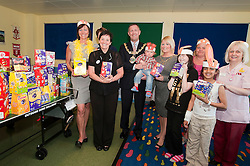 Julie and Deborah Cooper who are both Weight watchers group leaders for the Rotherham Area were Joined by the mayor of Rotherham Cllr Shaun Wright and Mayoress Lisa Wright for the Weight Watchers 10th Annual Easter Eggs Give Away to Rotherham Hospitals Childrens Ward. Also pictured left to right are Finley Clements, Cora Auckland Parent Hellen Cassell, Talibah Rahman and Play specialist Val aspin..Weight Watchers Give away Easter Eggs 120514..http://www.pauldaviddrabble.co.uk.29 March 2012 .Image © Paul David Drabble
