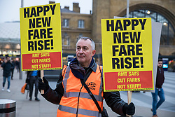 © Licensed to London News Pictures. 02/01/2018. London, UK. Commuters protest train ticket price increases at London Kings Cross Station. Rail fares have increased by an average of 3.4%, the biggest rise in five years. Photo credit: Rob Pinney/LNP