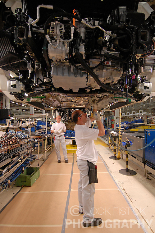 BRUSSELS, BELGIUM - MAY-30-2007 - Workers assemble VW and Audi cars on the production line at the Audi factory in Brussels, Belgium, Thursday, May 30, 2007. Audi AG, Volkswagen AG's luxury division, took control of the namesake brand's Brussels factory today to add capacity for building the new A1 small car. VW's will be produced until the end of the year at the Brussels factory.(PHOTO © JOCK FISTICK)