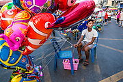 09 FEBRUARY 2014 - HAT YAI, SONGKHLA, THAILAND: An inflatable toy vendor waits for customers during Lunar New Year in Hat Yai. Hat Yai was originally settled by Chinese immigrants and still has a large ethnic Chinese population. Chinese holidays, especially Lunar New Year (Tet) and the Vegetarian Festival are important citywide holidays.     PHOTO BY JACK KURTZ