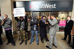 © Licensed to London News Pictures. 24/11/2011, London, UK. A business man argues with a protesters. Protesters with a megaphone cause the closure of a branch of Natwest near to the camp. Occupy UK protest camp at St Paul's Cathedral today 24 November 2011. Photo credit : Stephen Simpson/LNP