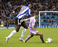 Reading's Oliver Norwood goes down under the challenge from Sheffield Wednesday's Lucas Joao<br /> <br /> Photographer Rich Linley/CameraSport<br /> <br /> Football - The Football League Sky Bet Championship - Sheffield Wednesday v Reading - Wednesday 19th August 2015 - Hillsborough - Sheffield<br /> <br /> © CameraSport - 43 Linden Ave. Countesthorpe. Leicester. England. LE8 5PG - Tel: +44 (0) 116 277 4147 - admin@camerasport.com - www.camerasport.com