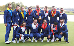 Team Europe's (top row, from the left to right) Henrik Stenson, Justin Rose, Alex Noren, Sergio Garcia, captain Thomas Bjorn, Ian Poulter, Jon Rahm, Paul Casey (bottom row, from left to right) Tommy Fleetwood, Tyrrell Hatton, Thorbjorn Olesen, Rory McIlroy and Francesco Molinari celebrate with the Ryder Cup during the Singles match on day three of the Ryder Cup at Le Golf National, Saint-Quentin-en-Yvelines, Paris.