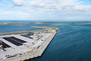 Nederland, Zuid-Holland, Rotterdam, 23-10-2013; Tweede Maasvlakte (MV2) met in de voorgrond de Prinses Amaliahaven en links de Prinsen Alexiahaven. Aanleg nieuwe containerterminal van Rotterdam World Gateway (RWG) met diepzee kadewal voor ultragrote schepen. Prinses Arianehaven midden rechts.<br /> New Maasvlakte (MV2), new harbour area Port of Rotterdam, artificial land.<br /> luchtfoto (toeslag op standard tarieven);<br /> aerial photo (additional fee required);<br /> copyright foto/photo Siebe Swart
