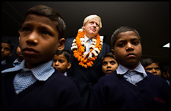 London Mayor Boris Johnson meets students and pupils during a visit to Amity University in Uttar Pradesh near Delhi, where he addressed members of the university and took questions from Indian students, on the second day of a six-day tour of India, where he will be trying to persuade Indian businesses to invest in London, Monday November 26, 2012. Photo by Andrew Parsons / i-Images
