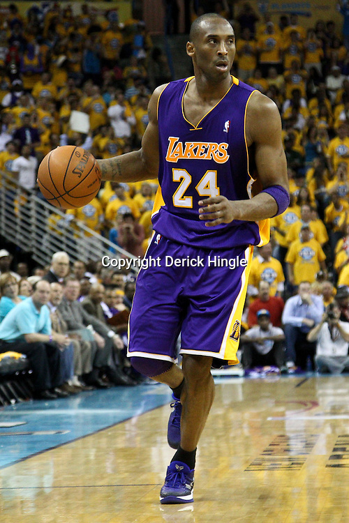 April 22, 2011; New Orleans, LA, USA; Los Angeles Lakers shooting guard Kobe Bryant (24) against the New Orleans Hornets during the second half in game three of the first round of the 2011 NBA playoffs at the New Orleans Arena. The Lakers defeated the Hornets 100-86.   Mandatory Credit: Derick E. Hingle