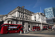 Old architecture of the Bank of England competes with new high rise modern glass buildings in the City of London, England, United Kingdom. As Londons financial district grows in height, the classical buildings with their columns are being dwarfed by the towers and skyscrapers of glass.