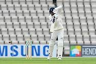 James Vince of Hampshire hits the ball to the boundary for four runs during the first day of the Specsavers County Champ Div 1 match between Hampshire County Cricket Club and Essex County Cricket Club at the Ageas Bowl, Southampton, United Kingdom on 5 April 2019.