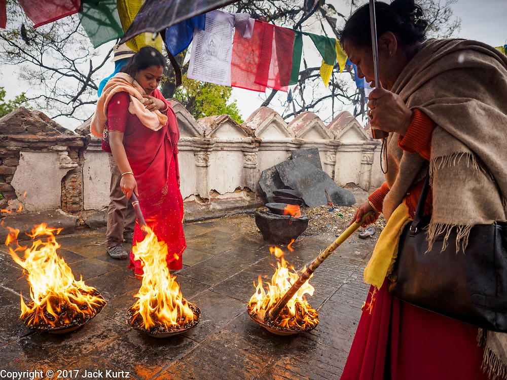 11 MARCH 2017 - KATHMANDU, NEPAL:  Nepali Hindus participate in a ceremony marking the one year anniversary of the death of a family member. The second most important Buddhist stupa in Kathmandu, Swayambhu Stupa is also a historic landmark and has panoramic views of Kathmandu. It is sacred to both Buddhists and Hindus. The stupa is being rebuilt because it was badly damaged in the 2015 earthquake.   PHOTO BY JACK KURTZ