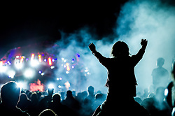 The silhouette of a young girl at the Brownstock Festival in Essex.
