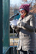 Bar Harbor, Maine, USA. 19 January, 2019. Milja Brecher Demuro addresses the crowd gathered on the Village Green for the Women's March Bar Harbor, a sister march of the national Women's March.