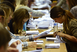 Election staff count ballot papers for the General Election, at the Peter Paine Performance Centre in Boston.