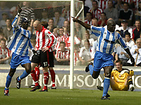 Photo Aidan Ellis, Digitalsport<br /> NORWAY ONLY<br /> <br /> Lincoln City v Huddersfield Town.<br /> Third Divison Play Off Semi Final 1st leg.<br /> 15/05/2004.<br /> Huddersfield's iffy Onuora celebrates with team mate Efetobore Sodje after heading his team into the lead