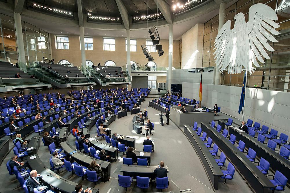 """25 MAR 2020, BERLIN/GERMANY:<br /> Uebersicht Plenarsaal - Um das Abstandsgebot zu beachten, ist nur jder dritte Platz in den Abgeordnentenreihen besetzt, Bundestagsdebatte zu """"COVID 19 - Kreditobergrenzen, Nachtragshaushalt, Wirtschaftsfonds"""", Plenum, Reichstagsgebaeude, Deutscher Bundestag<br /> IMAGE: 20200325-01-040<br /> KEYWORDS: Pandemie, Corona, Sitzung, Debatte, Übersicht"""