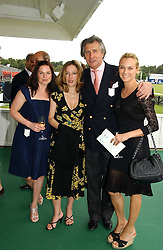 Left to right, EVA BIRTHISTLE, GILLIAN ANDERSON, ARNAUD BAMBERGER and DIANE KRUGER at the Queen's Cup polo final sponsored by Cartier at Guards Polo Club, Smith's Lawn, Windsor Great Park on 18th June 2006.  The Final was between Dubai and the Broncos polo teams with Dubai winning.<br />