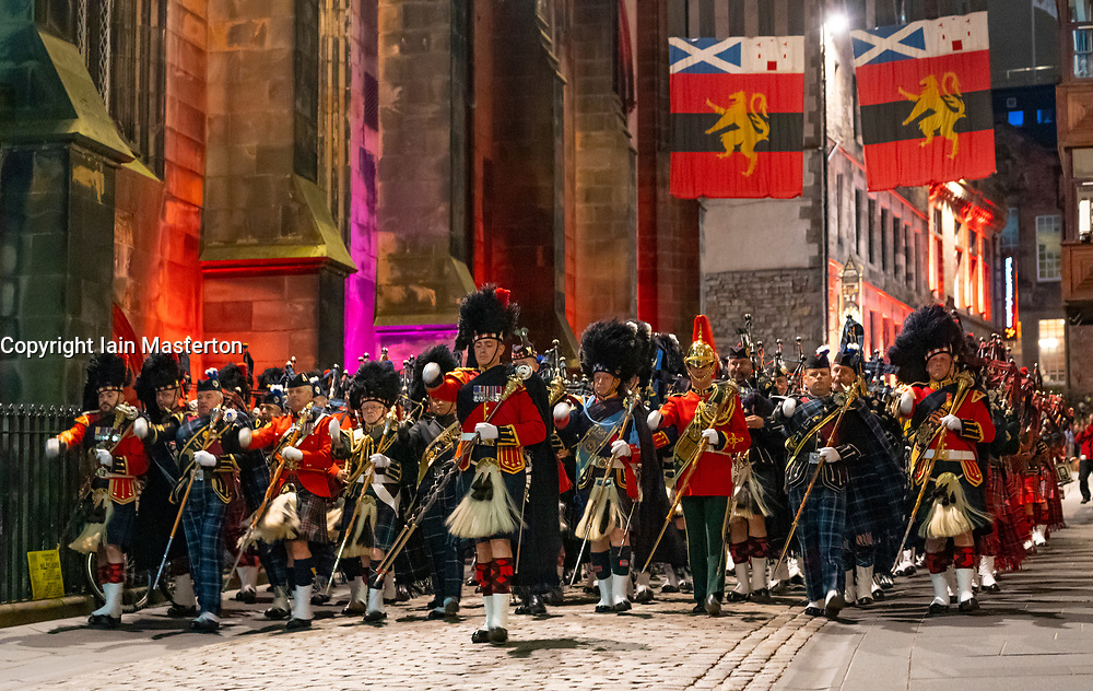 Edinburgh, Scotland, UK. 1 August, 2019. Preview opening night of the 2019 Royal Edinburgh Military Tattoo, performed on the esplanade at Edinburgh Castle. This is the Tattoo's 69th year and it runs from 2-24 August. Pictured the Massed Pipes and Drums march down towards Lawnmarket at the end of the Finale