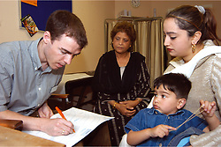 Two year old boy having development health check up with NHS Paediatrician at health centre Bradford Yorkshire UK