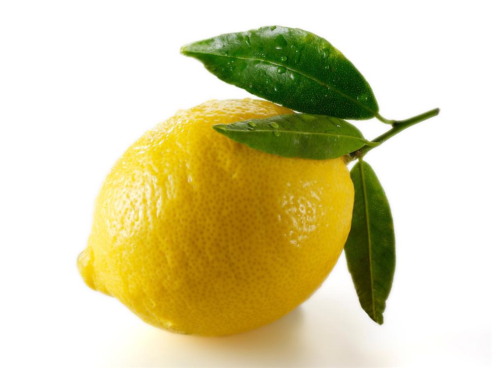 Fresh whole lemons with leaves