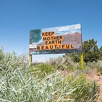 """Along Indian Rte 9301, a sign reads, """"Keep Mother Earth Beautiful"""" in St Michaels, AZ."""