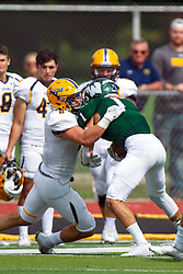 BLOOMINGTON, IL - September 28:  J.J. Cervino puts a stop to a long run by Trevor Koepke during a college football game between the IWU Titans and the Augustana Vikings on September 28 2019 at Wilder Field in Tucci Stadium in Bloomington, IL. (Photo by Alan Look)