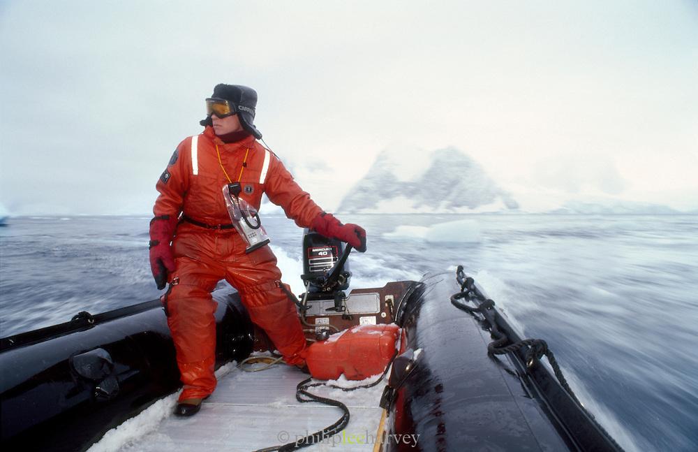 Expedition leader navigating Zodiac Inflatable craft at the Antarctic Peninsula, Antarctica