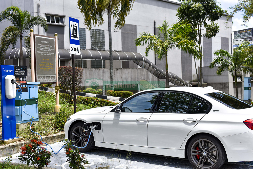 April 3, 2017 - Kuala Lumpur, MALAYSIA - BMW 330e iPerformance Sport plug-in hybrid charging at University of Malaya on April 03 2017 in Kuala Lumpur, Malaysia. .Malaysian Green Technology Corporation, Ahmad Hadri Haris, said from 2016, 2017 alone, we are going to have 300 charging stations. The goal over the next five years is to have 25,000 public charging stations (Credit Image: © Chris Jung via ZUMA Wire)
