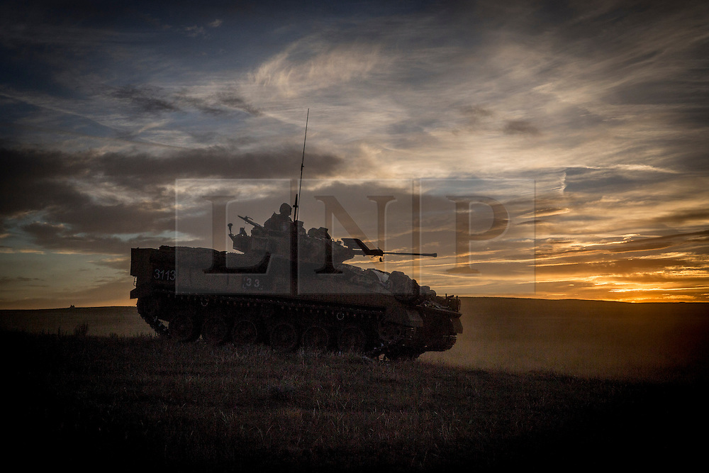 © Licensed to London News Pictures. 08/10/2014.  British Army Training Unit Suffield (BATUS), Canada. A warrior armoured vehicle returns to camp as a military exercise in Canada comes to an end.  <br /> <br /> BATUS has been home to the Army for the past 42 years.  It is the only place where all elements of the British Army train together for war.  The soldiers are put to test on everything from armoured vehicles to infantry tactics.        Photo credit : Alison Baskerville/LNP