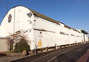 Historic corrugated iron warehouses, Ipswich Wet Dock waterside redevelopment, Ipswich, Suffolk, England, Uk