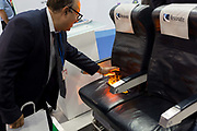 A demonstration by Resonate Testing Ltd. to illustrate that they test and contribute with the certification of fire-retardent airline seat materials, at the Farnborough Airshow, on 16th July 2018, in Farnborough, England.