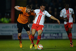 Wolves midfielder James Henry and Stevenage's defender Darius Charles  compete for the ball  - Photo mandatory by-line: Mitchell Gunn/JMP - Tel: Mobile: 07966 386802 01/04/2014 - SPORT - FOOTBALL - Broadhall Way - Stevenage - Stevenage v Wolverhampton Wanderers - League One
