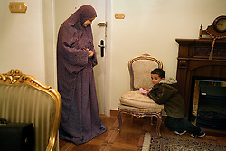 The wife of Amr Khaled, and their son Ali, 4, are seen inside their home in the Mohandessin neighborhood of Cairo, Egypt, Dec. 28, 2005.  Khaled, an Islamic televangelist, had previously been asked to leave Egypt as his revival gained strength. As a result he started preaching on several television shows, turning him into an international celebrity. Some religious scholars complain that Khaled has not been properly trained in Islam to command such a following.