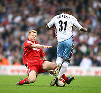 LIVERPOOL, ENGLAND - SATURDAY, OCTOBER 28th, 2006: Liverpool's John Arne Riise and Aston Villa's Didier Agathe during the Premiership match at Anfield. <br />