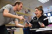 Junior Esmeralda Perez reacts when she finds the same answer on her AP Physics homework as tutor Ian Wessen of San Jose during the EOS tutoring class during lunch at Milpitas High School in Milpitas, California, on October 13, 2014. (Stan Olszewski/SOSKIphoto)