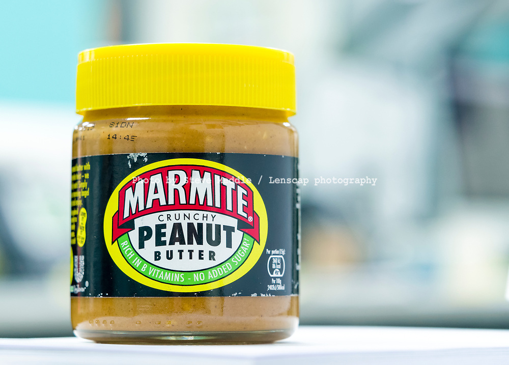 London, England - March 25, 2019:  Jar of Marmite Crunchy Peanut Butter, The original Marmite is made by Unilever and first launched in 1902.