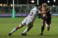 Angus O'Brien of the Newport Gwent Dragons takes Arnaud Mignardi of Brive on the inside. European Challenge cup pool 3 match, Newport Gwent Dragons v Brive, at Rodney Parade in Newport, South Wales on Friday 14th October 2016.<br /> pic by  Simon Latham, Andrew Orchard sports photography.