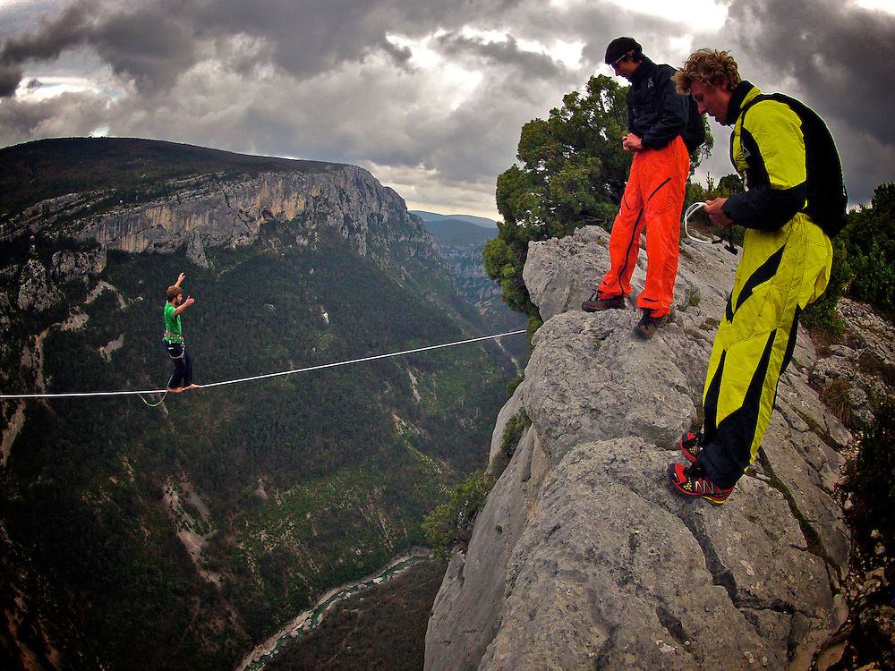 Nadeem AL-Kafaji onsighting an highline in Gorges du Verdon's sector of  Dalles Grises, France, while BASE jumpers Mich Kemeter and Tancrede Melet get ready for another dawn, 300m cliff dive...2012 © Pedro Pimentel