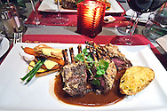 A meal of Rack of Lamb served with potato and asparagus.