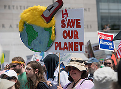 April 29, 2017 - Washington, District of Columbia, U.S - Demonstrators march down Pennsylvania Avenue during the People's Climate March, to protest U.S. President Trump's stance on the environment. (Credit Image: © Robin Loznak via ZUMA Wire)