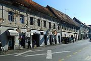 Main street, with many buildings still showing damage from 1991 -- 1995 war. Petrinja, Croatia