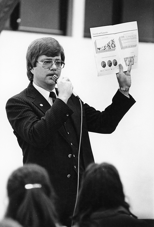 ©1993 Public Speaking:  Manager giving a presentation to employees at an all hands meeting. Austin, TX