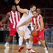 Olympiacos's Vassilis SPANOULIS (R) during their Two Nations Cup basketball match Anadolu Efes between Olympiacos at Abdi Ipekci Arena in Istanbul Turkey on Sunday 02 October 2011. Photo by TURKPIX