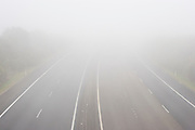 Thick fog blanketing State Highway 1 in the Bombay Hills, south of Auckland, New Zealand.