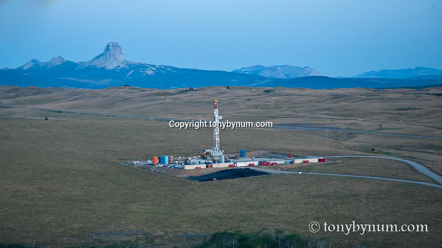 oil drilling rig drilling on blackfeet reservation glacier national park background conservation photography - blackfeet oil